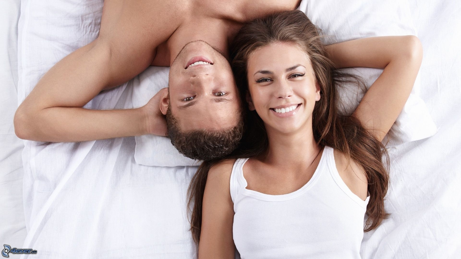 couple-on-bed-159679